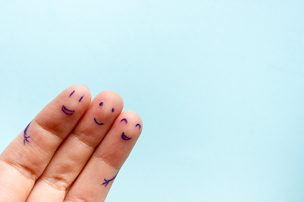 Three smiling fingers that are very happy.